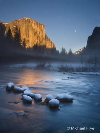 The moon rising between El Capitan and Cathedral Rocks from Valley View