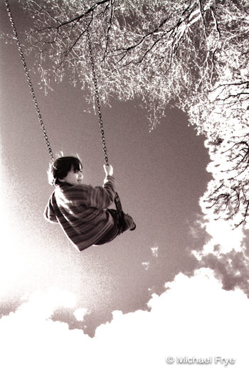 My son Kevin on a swing at age three