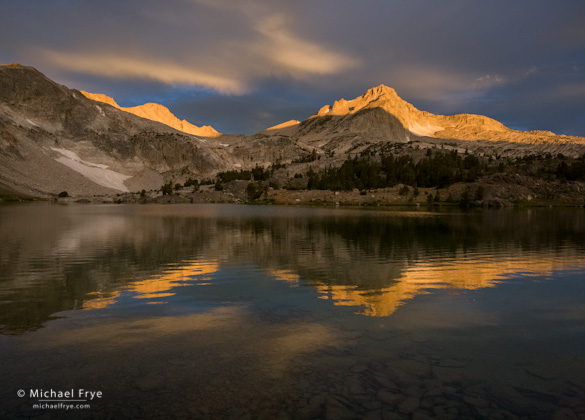 Sunrise illuminates North Peak. I like the rippled reflection, preserved by a fast shutter speed (1/90th sec)