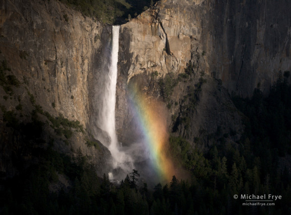 Bridalveil Fall and rainbow, Yosemite. Sun breaking through clouds created occasional spots of sunlight on the waterfall. I waited and hoped for a moment like this, when the sun spotlit the waterfall created natural vignetting.