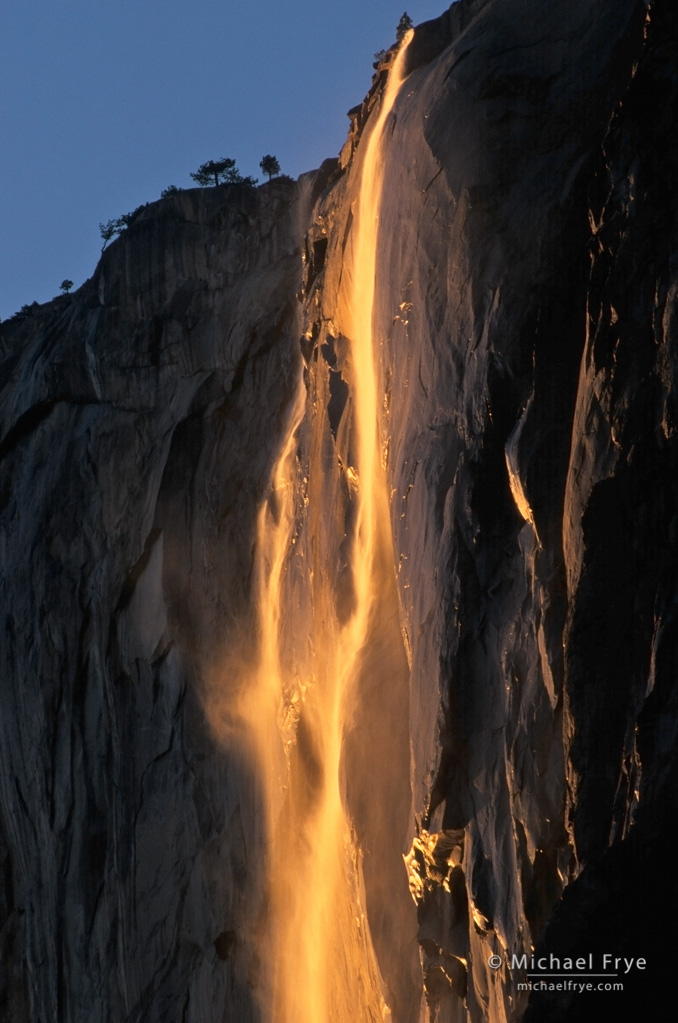Horsetail Fall at sunset, Yosemite. Another backlit, translucent subject against a dark background.