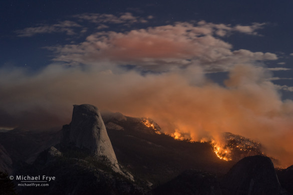 Meadow Fire burning next to Half Dome at night, Yosemite NP, CA, USA; 9-7-14